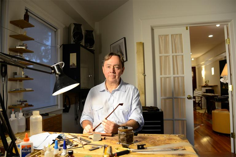 Benoit Rolland, in his home bow-making studio (Courtesy of the John D. & Catherine T. MacArthur Foundation)