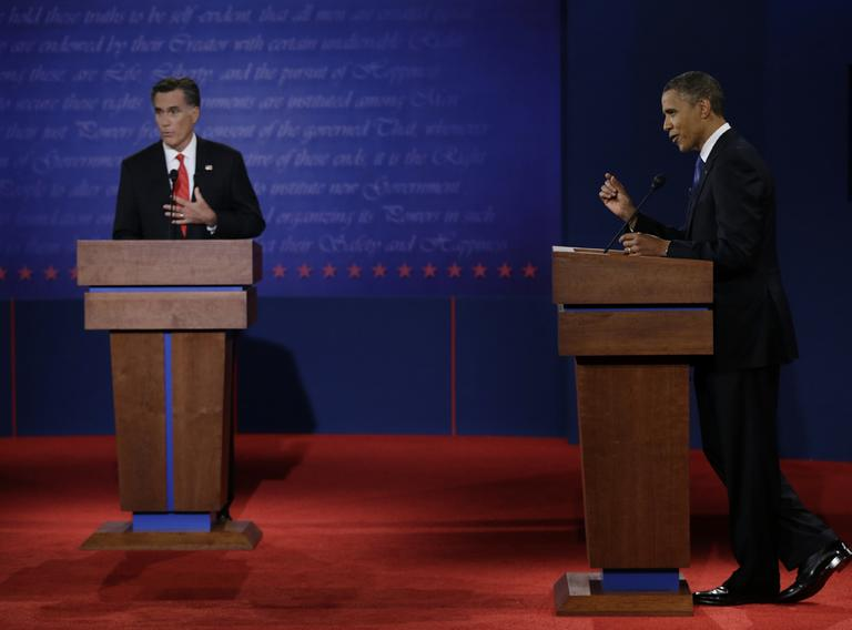 Republican presidential nominee Mitt Romney, left, and President Barack Obama speak during the first presidential debate at the University of Denver, Wednesday, Oct. 3, 2012, in Denver. (AP)