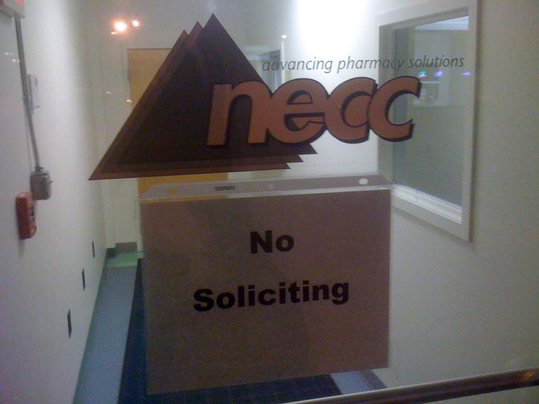 A sign on the door to the New England Compounding Center requests no soliciting at the Framingham, Mass. company. (AP)
