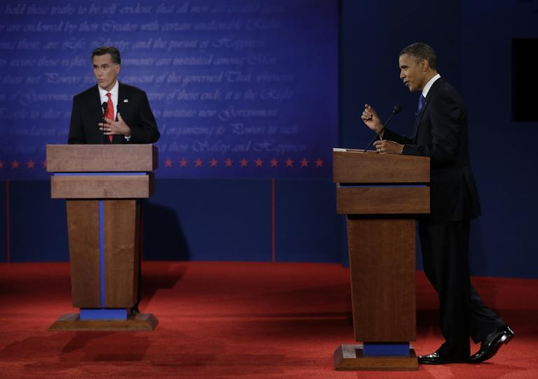 Republican presidential nominee Mitt Romney, left, and President Barack Obama speak during the first presidential debate at the University of Denver, Wednesday, in Denver. (AP)