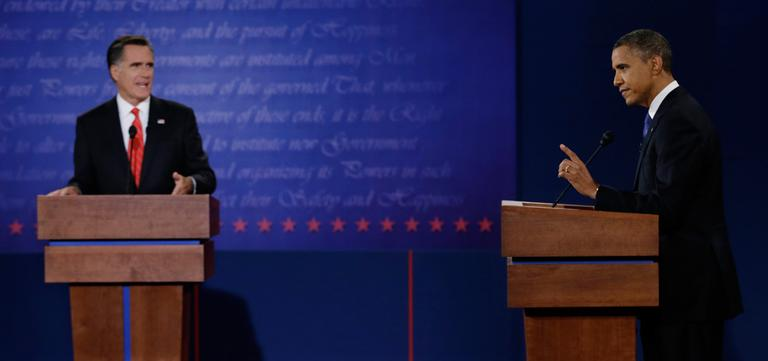 President Obama and Republican presidential nominee Mitt Romney speak during the first presidential debate at the University of Denver, Wednesday. (Eric Gay/AP)