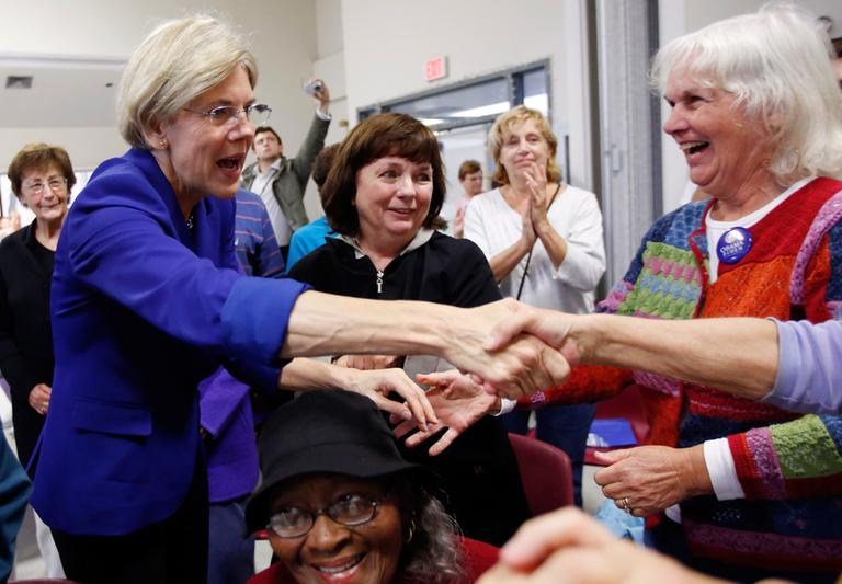 Democratic U.S. Senate candidate Elizabeth Warren, left, greets supporters during a campaign stop at a senior center in Medford Wednesday. (Michael Dwyer/AP)