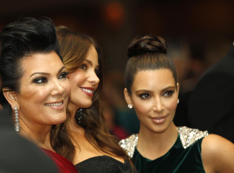 Kris Jenner, left, with Sofia Vergara, center, and Kim Kardashian during the White House Correspondents' Association Dinner headlined by late-night comic Jimmy Kimmel, Saturday, April 28, 2012 in Washington. (AP)