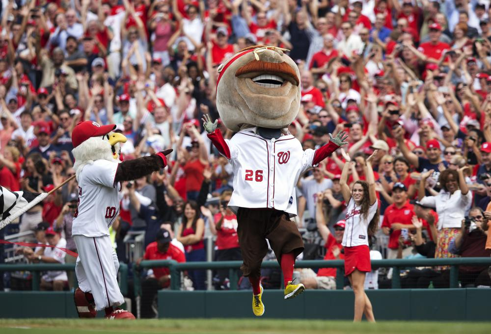 Teddy Roosevelt celebrates after his first-ever victory in the history of the Presidents' Race at Nationals Park. (AP/Manuel Balce Ceneta)