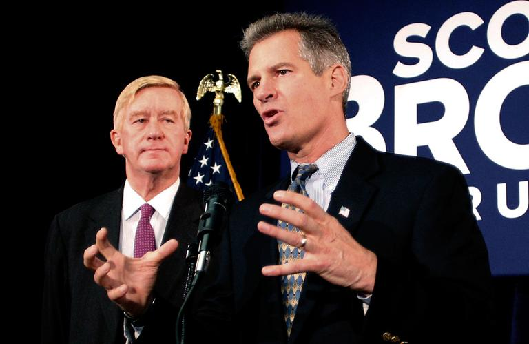 U.S. Sen. Scott Brown speaks with reporters as former Massachusetts Gov. William Weld looks on after Weld endorsed Brown in Boston Friday. (Winslow Townson/AP)
