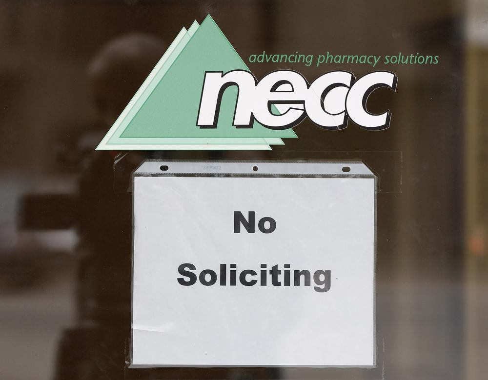 "A sign requesting ""No Soliciting"" hangs on the door of New England Compounding in Framingham, Mass., Thursday, Oct. 4, 2012. (AP Photo/Stephan Savoia)"