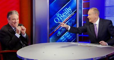 """The O'Reilly Factor"" host Bill O'Reilly points across the table at ""Daily Show"" host Jon Stewart, on the set of the ""The O'Reilly Factor,"" in this 2010 file photo. (AP/Fox News)"