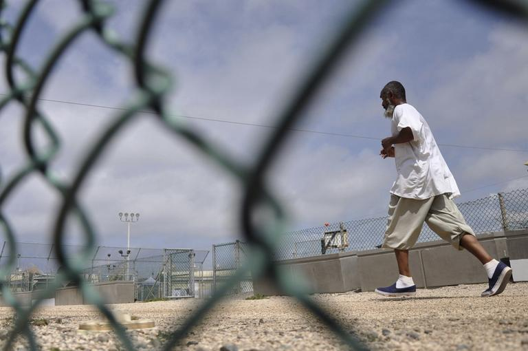 A Guantanamo detainee runs in an exercise area at the detention facility on Guantanamo Bay U.S. Naval Base in Cuba in April 2010. (AP/Michelle Shephard)
