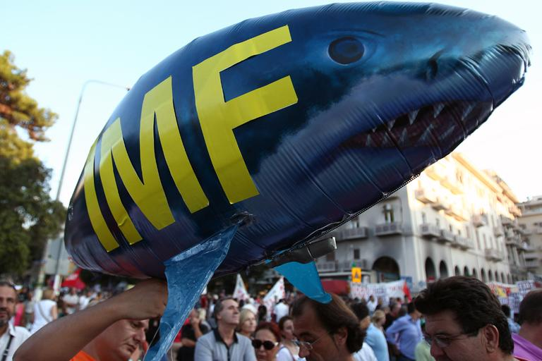 Protesters hold a shark balloon, featuring International Monetary Fund (IMF) in the northern Greek port city of Thessaloniki, Saturday, Sept. 8, 2012. Greek Prime Minister Antonis Samaras says the final round of austerity measures contains painful and unjust cuts but is necessary to restore Greece's credibility and continue to receive funding from creditors. (AP)