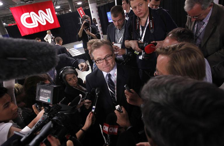 Eric Fehrnstrom speaks to the media on behalf of the Mitt Romney campaign following a Republican presidential debate in October 2011. (AP/Isaac Brekken)