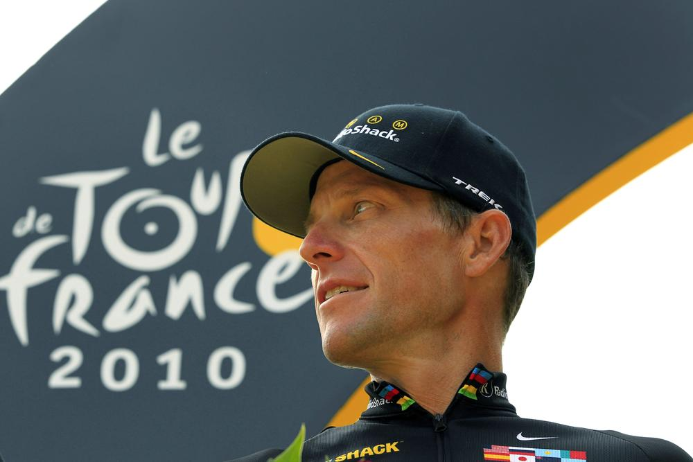 Lance Armstrong stands on the podium after the 20th and final stage of the 2010 Tour de France. The U.S. Anti-Doping Agency took testimony from other cyclists and determined Armstrong was part of a doping scheme during the years he won his seven Tours. (Bas Czerwinski/AP)