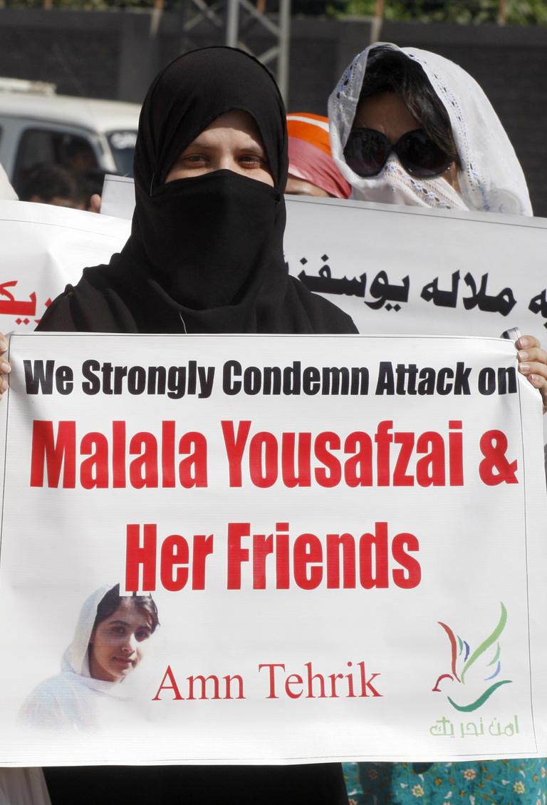 Pakistani protesters rally on Wednesday to condemn the attack on schoolgirl Malala Yousufzai. (Mohammad Sajjad/AP)