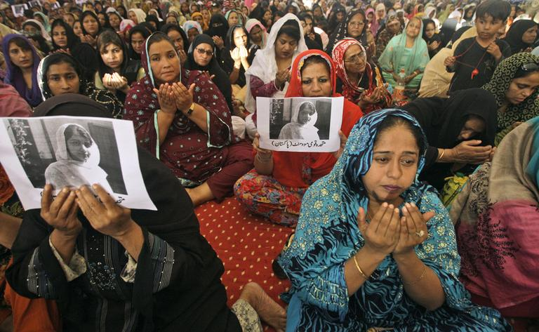 Supporters of Pakistani political party Muttahida Qaumi Movement chant prayers in support of 14-year-old schoolgirl Malala Yousufzai, who was shot on Tuesday by the Taliban for speaking out in support of education for women. (Shakil Adil/AP)