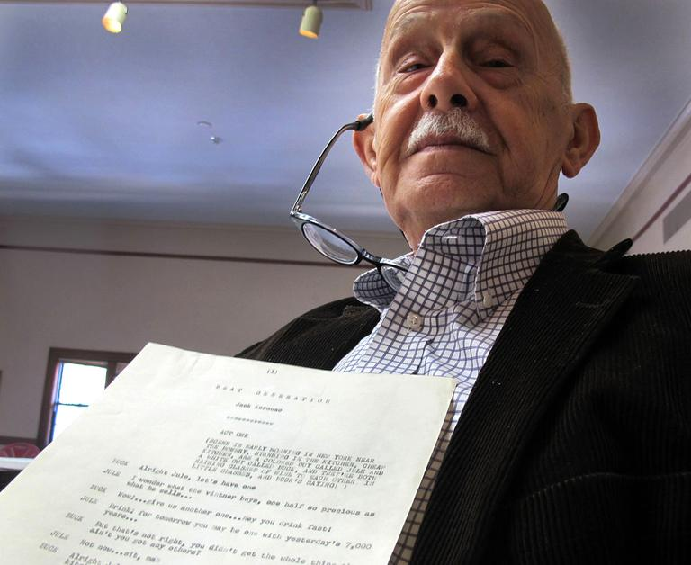 Kerouac estate executor John Sampas holds the original 1957 script. (Andrea Shea/WBUR)