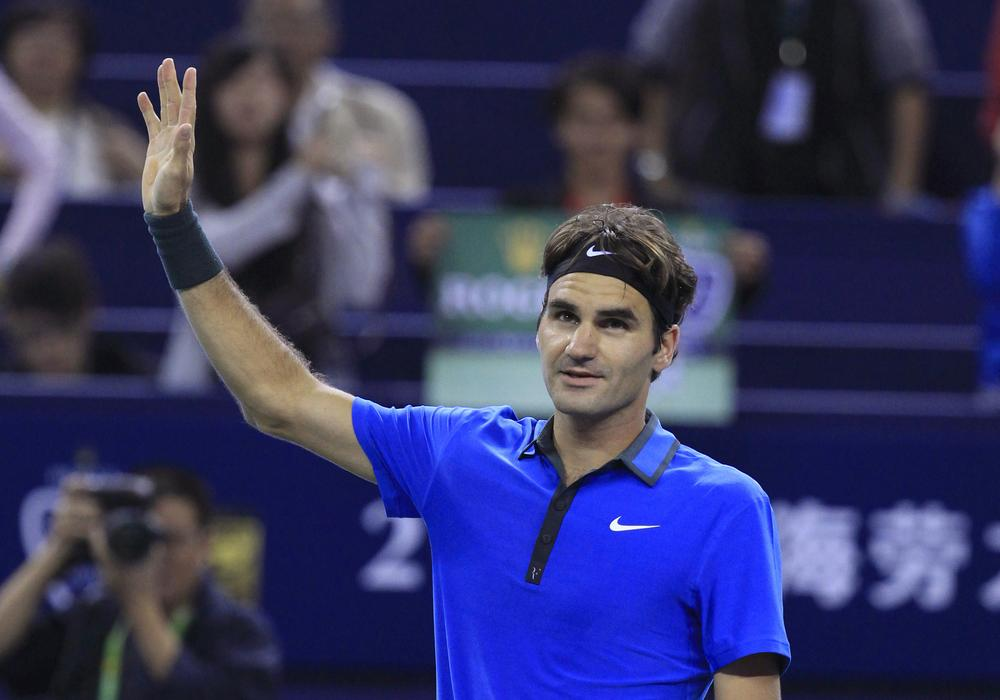 This week marks Roger Federer's 300th week in his career as the ATP Tour's No. 1 player. Pete Sampras held the previous record of 286 weeks. (AP/Eugene Hoshiko)