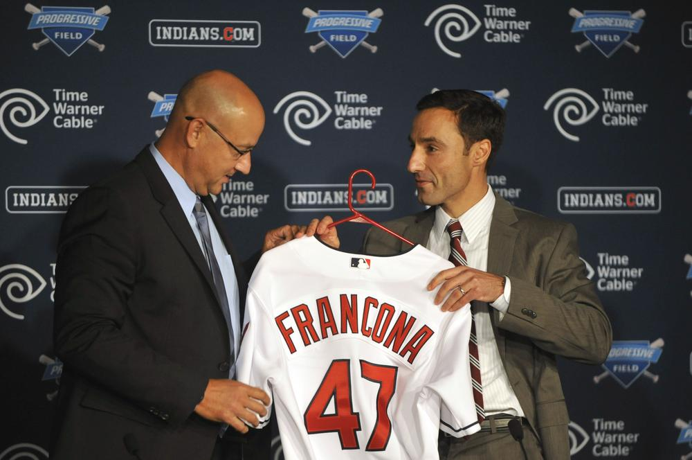 Terry Francona accepts a jersey from Cleveland Indians GM Chris Antonetti. (AP/David Richard)
