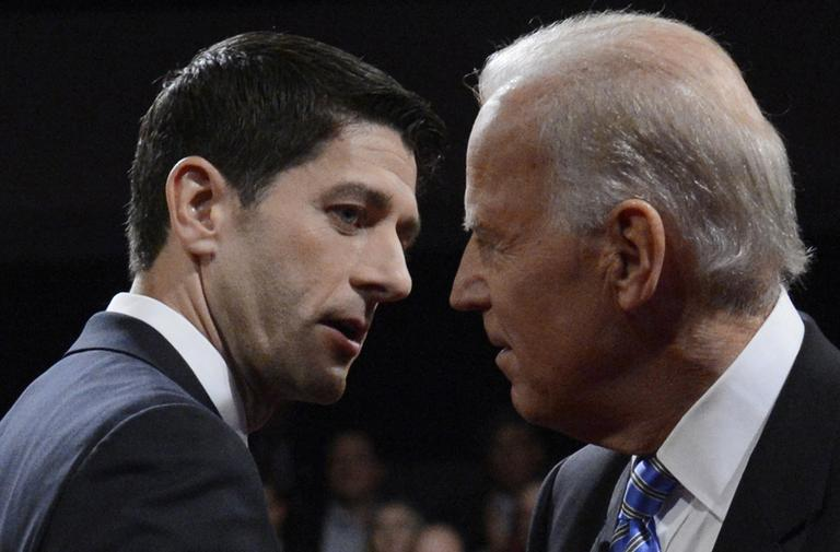 Vice President Joe Biden and Republican vice presidential nominee Rep. Paul Ryan shake hands after the vice presidential debate at Centre College in Danville, Ky. on Thursday. (Michael Reynolds/AP)