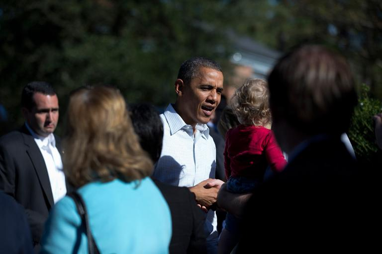 President Obama greets people outside a campaign field office Sunday in Williamsburg, Va. (Carolyn Kaster/AP)