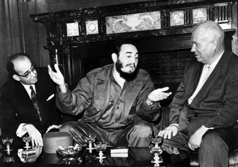 In this 1960 photo, Cuba's leader Fidel Castro, center, speaks with Soviet Premier Nikita Khrushchev, right, as his Foreign Minister Raul Roa, left, looks on during the United Nations General Assembly in New York. The world stood at the brink of Armageddon for 13 days in October 1962 when President John F. Kennedy drew a symbolic line in the Atlantic and warned of dire consequences if Soviet Premier Nikita Khrushchev dared to cross it. (AP/Prensa Latina)