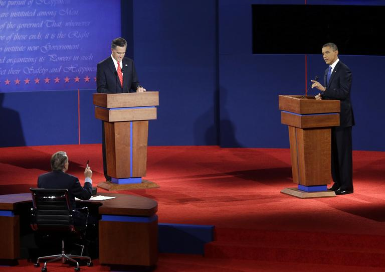 Moderator Jim Lehrer, far left, Republican presidential candidate, former Massachusetts Gov. Mitt Romney, left, and President Barack Obama, right, participate in the first presidential debate at the University of Denver on Oct. 3, 2012. (AP/Pablo Martinez Monsivais)