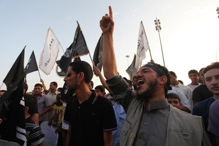 Libyan followers of the Ansar al-Shariah Brigades chant anti-U.S. slogans during a protest in September, as part of widespread anger over a film ridiculing Islam's Prophet Muhammad. The Libyan-based Islamic militant group Ansar al-Shariah is one of the leading suspects in the attack on the U.S. consulate in Libya that killed the U.S. ambassador and three other Americans. (AP/Mohammad Hannon)