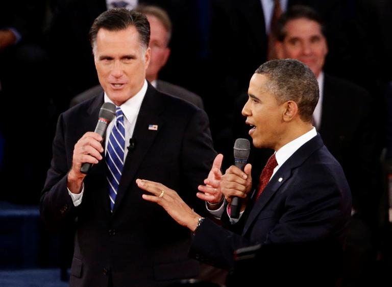 President Obama and Republican presidential candidate Mitt Romney speak during the second presidential debate at Hofstra University in Hempstead, N.Y., on Tuesday. (AP/Charles Dharapak)