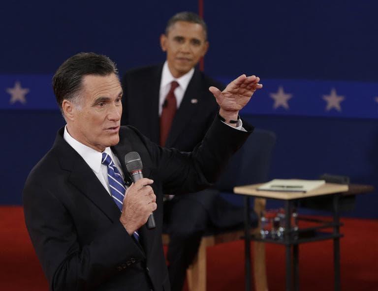 President Barack Obama listens as Republican presidential nominee Mitt Romney speaks during the second presidential debate on Tuesday. (AP)