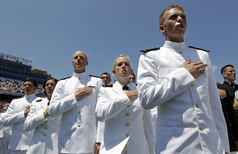 "Graduating midshipmen sing ""Navy Blue and Gold,"" the U.S. Naval Academy's alma mater, during the Academy's graduation and commissioning ceremonies in Annapolis, Md., in May 2012. (AP/Patrick Semansky)"