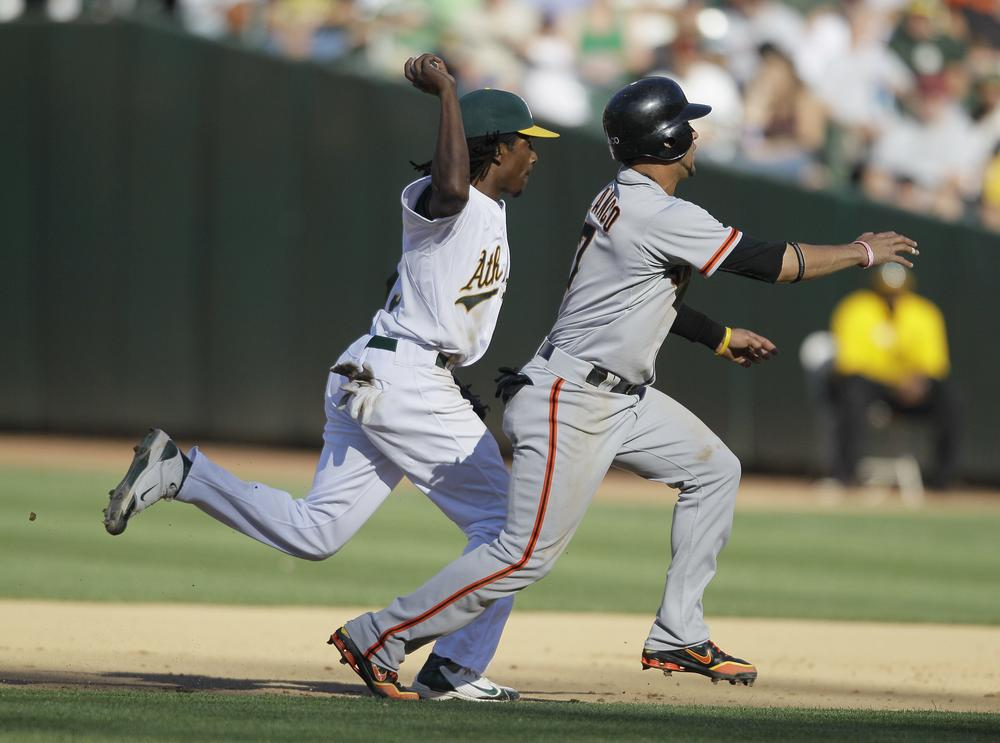 In the race for Bay Area prominence, the San Francisco Giants may win for packed stadiums and well-known players, but this season the Oakland Athletics had the element of surprise with an unexpected playoff run. (Eric Risberg/AP)