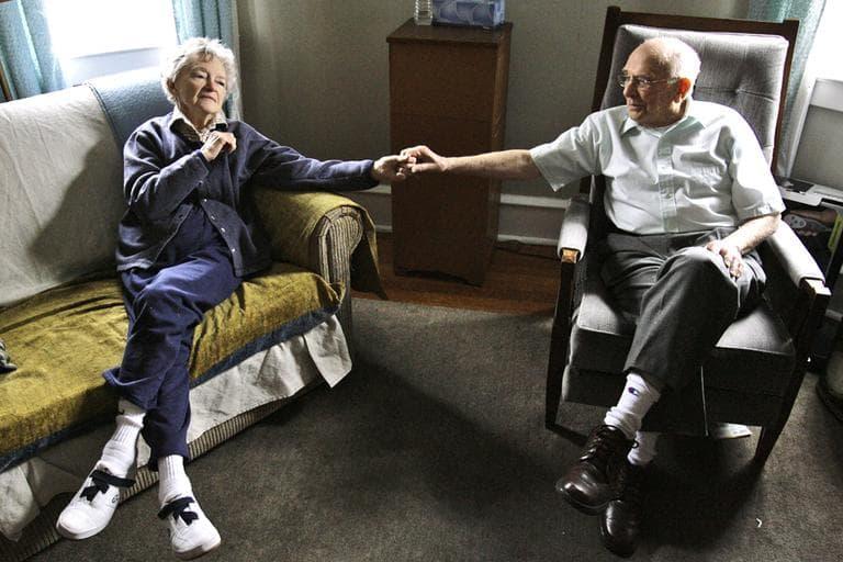 Alzheimer's patient Dorothy Eckert and her husband John Eckert hold hands at their home in Norristown, Pa. (AP/Matt Rourke)