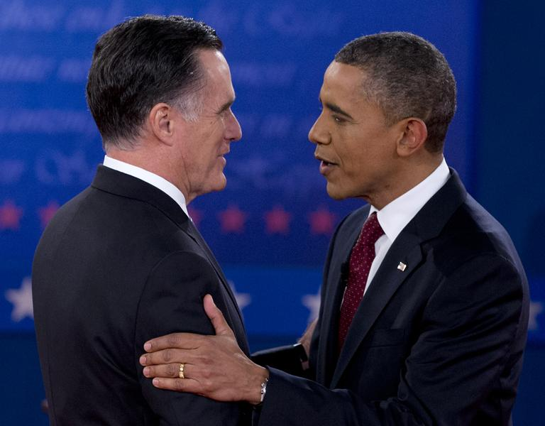 President Obama and Republican presidential candidate Mitt Romney greet each other at the second presidential debate, on Oct. 16. (Carolyn Kaster/AP)
