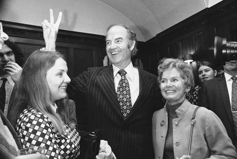 Sen. George McGovern signals victory as he talked with newsmen in April 1972 in Boston, after he won the Massachusetts Democratic presidential primary. (AP)