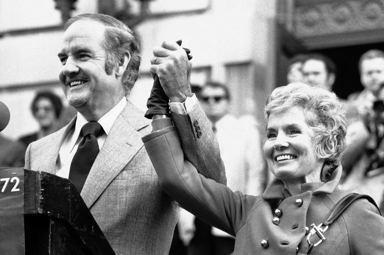 In this Oct. 31, 1972 photo, Sen. George McGovern holds up the hand of his wife Eleanor and announced to the crowd that it was their 29th wedding anniversary. (AP/Bob Schutz)