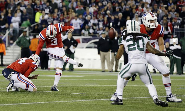 Patriots kicker Stephen Gostkowski makes the winning field goal against the Jets in overtime on Sunday. (Elise Amendola/AP)