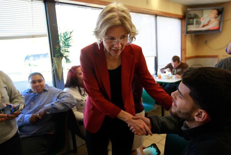 Democratic U.S. Senate candidate Elizabeth Warren campaigns at the Puerto Rico Bakery in Springfield Monday. (Steven Senne/AP)