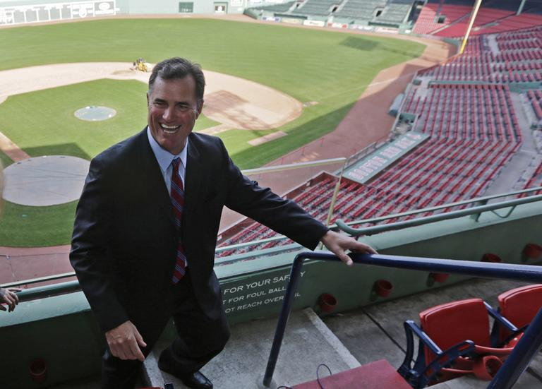 John Farrell walks through the stands at Fenway Park on Tuesday after being introduced as the Red Sox 46th manager. (Charles Krupa/AP)