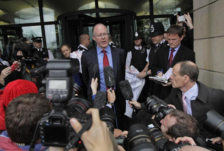 George Entwistle, center, the British Broadcasting Corporation (BBC) Director General, talks to members of the media on Tuesday. Entwistle told British lawmakers on Tuesday that it is too early to say whether sexual abuse was endemic within Britain's publicly funded national broadcaster. (AP/Lefteris Pitarakis)