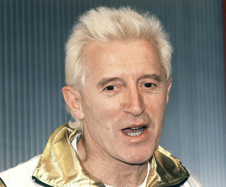 A 1986 photo of British disc jockey and BBC TV presenter Jimmy Savile. (AP/John Redman)