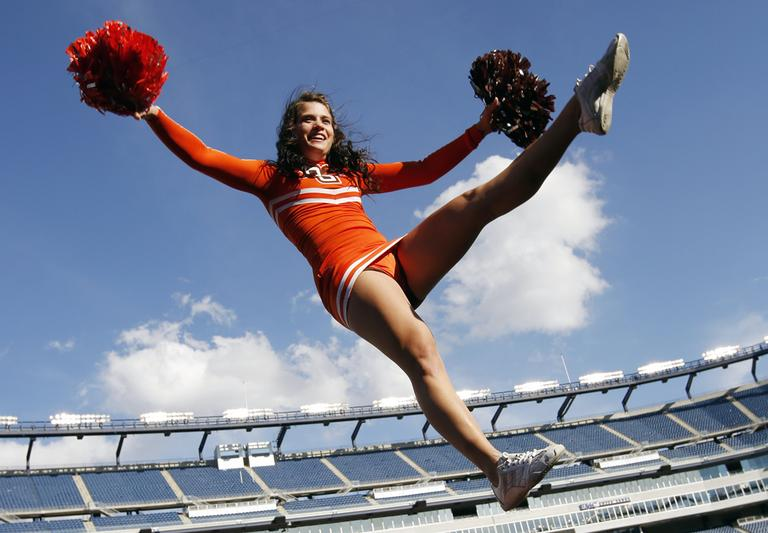 A Bowling Green cheerleader performs during an NCAA college football game against Massachusetts in Foxborough, Mass., Saturday, Oct. 20, 2012. (AP)