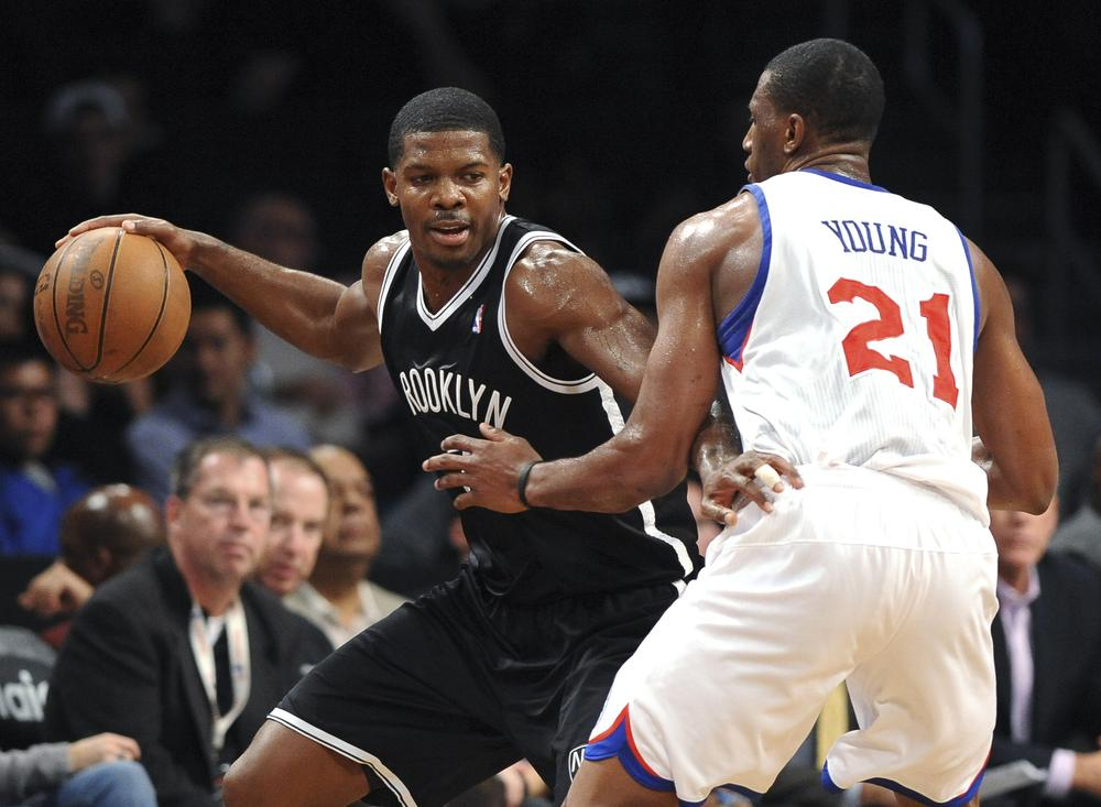 The Brooklyn Nets play the Philadelphia 76ers in an NBA preseason game in New York. The Nets open regular season in their new home on Nov. 1, against the New York Knicks. (Kathy Kmonicek/AP)
