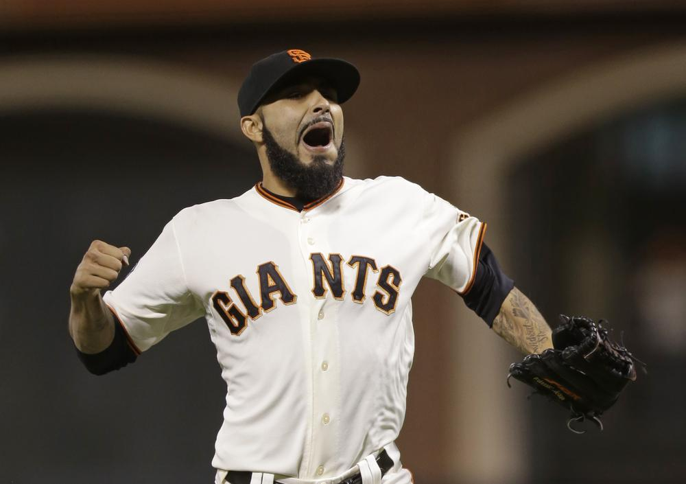 San Francisco Giants pitcher Sergio Romo reacts after the Giants won 2-0 over the Detroit Tigers in Game 2 of the World Series. The series moves to Detroit for Game 3. (Marcio Jose Sanchez/AP)