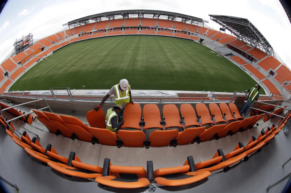 Workers install seats at the Houston Dynamo's new stadium. The 22,000-seat BBVA Compass Stadium opened in May. (David J. Phillip/AP)