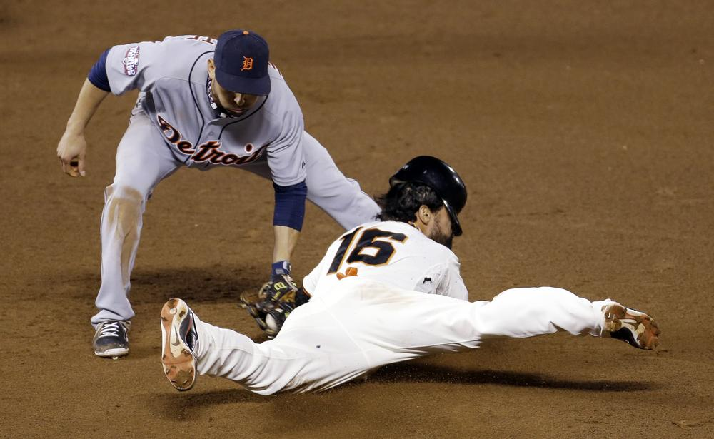The San Francisco Giants beat the Detroit Tigers in the first two games of the World Series, thanks in part to plays like this one. (AP Photo/Eric Risberg)