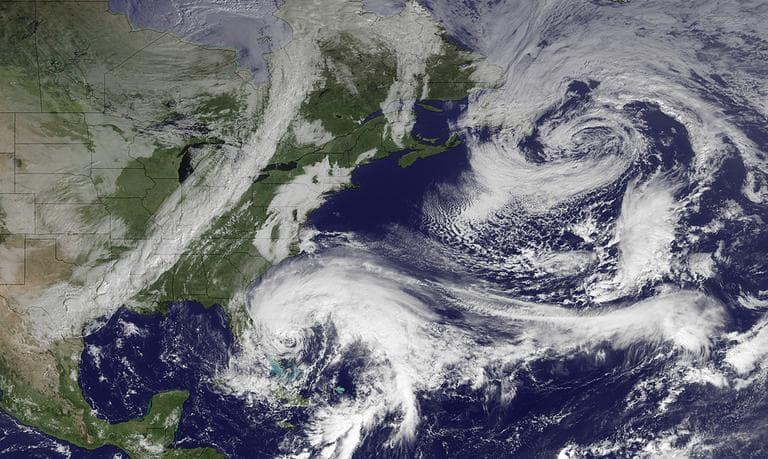 In this image taken Friday, Hurricane Sandy (center bottom) is seen. (AP/NOAA)