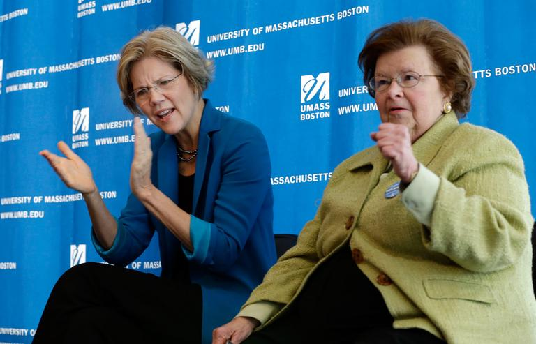 Democratic U.S. Senate candidate Elizabeth Warren, left, applauds as U.S. Sen. Barbara Mikulski, D-Md., gestures during a campaign event at University of Massachusetts-Boston, Friday. (Elise Amendola/AP)