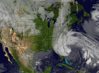 Cloud cover from Hurricane Sandy interacts with the long line of clouds associated with the cold front approaching the eastern U.S. The composite image was created using the Space Science and Engineering Center's McIDAS software and the National Oceanic and Atmospheric Administration's GOES imager satellite imagery. (NOAA/UWI/SSEC)
