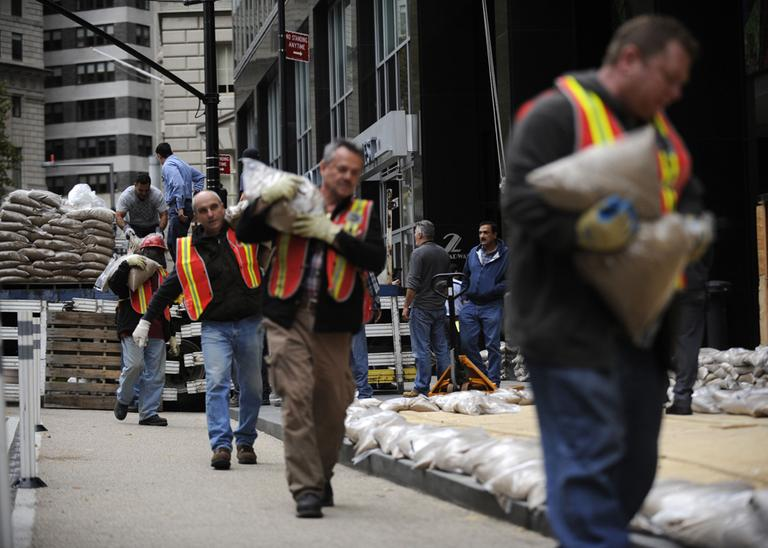 Sandbags are lined up in front of No. 2 Broadway in Battery Park in preparation of Hurricane Sandy Sunday, Oct. 28, 2012, in New York. (Louis Lanzano/AP)