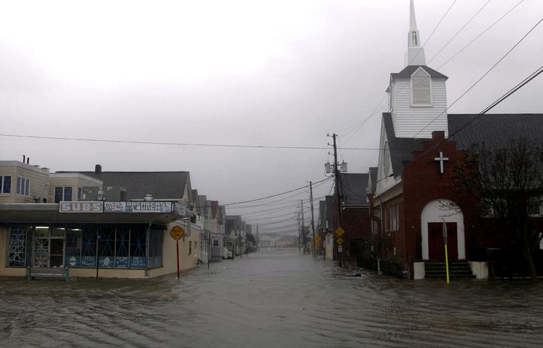 Waters flood Ocean Ave. in Sea Bright, N.J., on Monday. Hurricane Sandy continued on its path, as the storm forced the shutdown of mass transit, schools and financial markets, sending coastal residents fleeing, and threatening a dangerous mix of high winds and soaking rain. (AP/Seth Wenig)