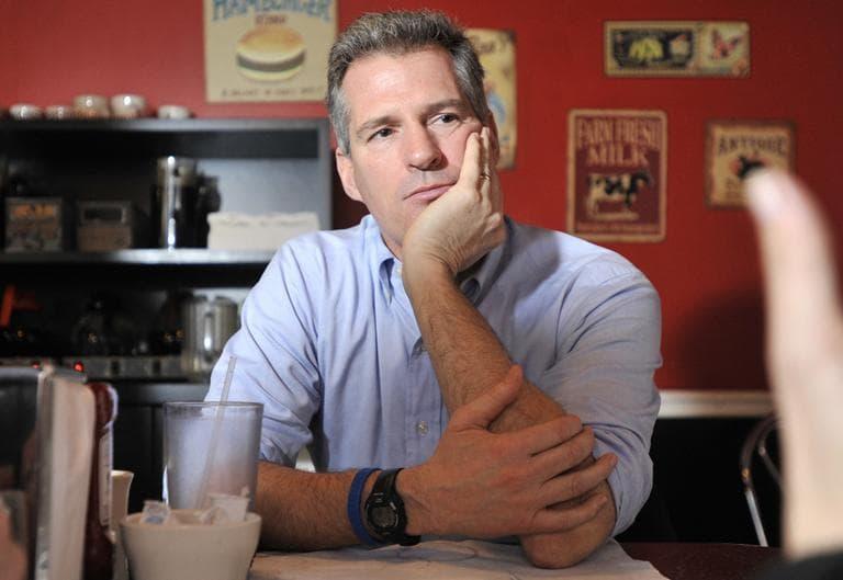 Sen. Scott Brown speaks with reporters at Mul's Diner in Boston in 2011. (Josh Reynolds/AP)