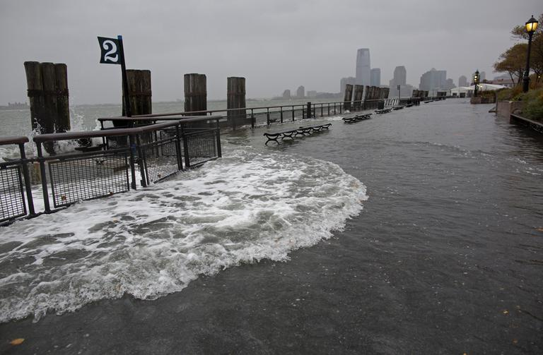 Waves wash over the seawall near high tide at Battery Park in New York on Monday, as Hurricane Sandy approaches the East Coast. (AP/Craig Ruttle)